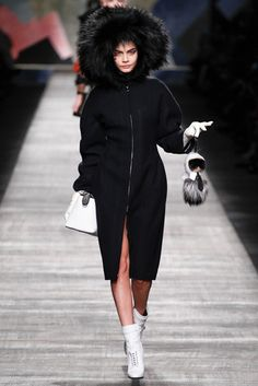 The biggest Milan fashion moment: Hooded Cara Delevingne + Karl bag bug. To view, visit: http://www.vogue.in/content/milan-fashion-week-looks-we-loved#9