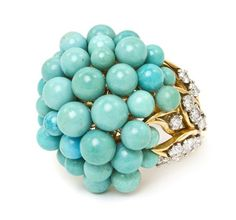 An 18 Karat Yellow Gold, Turquoise and Diamond Cluster Ring, 13.20 dwts.