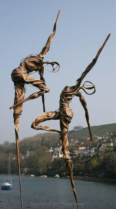 Angels in Harlem by Penny Hardy ~ Contemporary dance sculptures on stilts designed to gently sway in the breeze.