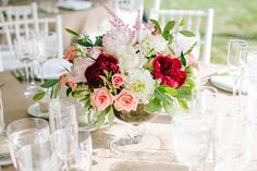 Red white and pink centerpiece featuring roses and peonies.