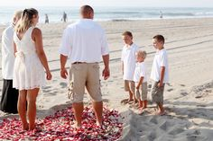 Jonathon and MIchelle celebrate with OceanCity.Wedding  Sand heart filled with rose petals, and the Beach Unity Ceremony to include not only his wife, but their three sons.