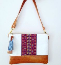 Beautifully made bag. Measures 10 inches by 9 inches. Made with genuine leather and fabric.