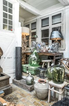 Glass domes and antique demi-johns;  © Paulina Arcklin | RUE VERTE PLUS store in Copenhagen