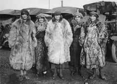 Dressed in a rather exotic uniform of army boots, army caps and fur coats, this image shows five female members of the First Aid Nursing Yeomanry standing in front of some Red Cross ambulances. As the first female recruits of this organization came from the ranks of the upper classes, perhaps the fur coats should not be too surprising. The women would have worked as drivers, nurses and cooks. Established by Lord Kitchener in 1907, the First Aid Nursing Yeomanry (FANY) was initially an…