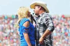 Trisha Yearwood and Garth Brooks perform at the Oklahoma Twister Relief Concert to benefit United Way. MORE exclusives pictures from the event >> http://www.gactv.com/gac/ar_artists_a-z/article/0,,GAC_26071_6063922,00.html?soc=social_20130708_9561124?soc=pinterest