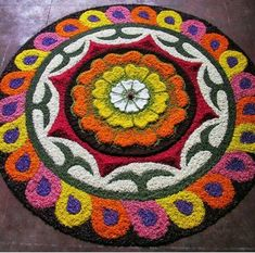Flower petals Rangoli designs images are special kind of Rangoli designs which are drawn on special occasions. Rangoli Designs Flower, Colorful Rangoli Designs, Rangoli Designs Diwali, Diwali Rangoli, Rangoli Designs Images, Flower Rangoli, Beautiful Rangoli Designs, Flower Designs, Indian Rangoli
