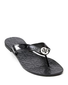 488232a1e612c Tory Burch s signature flip flops are a classic pair for the beach or  walking comfortably around