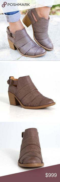 """Coming SoonTaupe Strapped Cutout Bootie Coming Soon!   Taupe Strapped Cutout Bootie  They pair perfectly with your favorite distressed jeans and vintage tee or dress them up with a colorful floral top.   •Vegan leather/ All man-made materials.  •Side cut-out  •Buckle entry •Strappy detail across the boot.  •2.5"""" heel  Price will not exceed $48  Like to be notified of arrival.  Comment to reserve your size. Shoes Ankle Boots & Booties"""