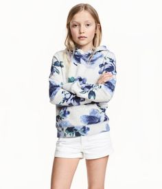 Check this out! Sweatshirt in soft fabric with a text motif, jersey-lined hood, kangaroo pocket, and ribbing at cuffs and hem. Soft, brushed inside. - Visit hm.com to see more.