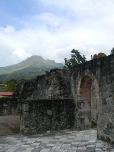 ruins of Le Theatre with Mount Pelle in the background St Pierre, Destinations, Mount Rushmore, Caribbean, To Go, Europe, America, Island, Mountains