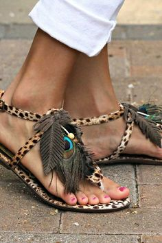 I love the details on these sandals.  Feathers!  :)