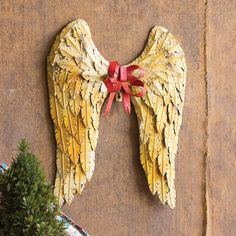 I know you're an angle, so should you have the wings too.Bring in the Christmas Cheer with this pair of elegant Angel Wings.Textured and distressed metal feathe