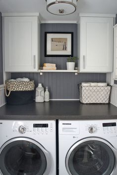 Small laundry-room-organization. Breadboards, baskets, a removable surface.