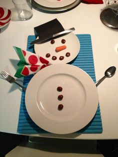 Christmas place setting!  Milk duds mini carrots black cocktail napkin and festive napkin! Frosty on your table!