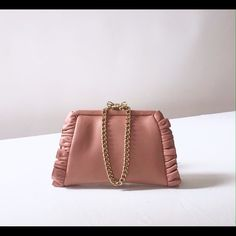 """Valentino Chain Wristlet Clutch Purse Bow Clasp Red - Valentino top opening small frame wristlet in light pink napa leather with ruffle trim along the edges. Fabric lined interior and single wall pocket. Gold-tone bow clasp closure & chain wrist strap. Never used and in perfect condition. Length 7.5""""  Height 5"""" Valentino Bags Clutches & Wristlets"""