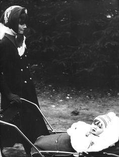 December 1970, Audrey Hepburn Dotti photographed with her youngest son Luca Dotti (in the pram) by Armando Pietrangeli in Gstaad (Switzerland).