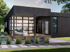 Also at the 2015 National Home Show: another pre-engineered home from Bonneville.  ONYX's crown jewel has to be the kitchen, which extends out toward the covered deck. The sliding countertop can double as a bar or an informal dining area. The roll-up glass doors and motorized solar panels open the home to the outside