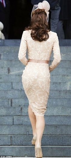Royal blush: Kate shone in the slim-fitting Dress, her slender waist accentuated by the ribbon belt, Beautiful View of the Back of the Dress, as Duchess Kate walks up the stairs