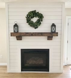 Shiplap fireplace with magnolia wreath and floating wood mantel. - Shiplap fireplace with magnolia wreath and floating wood mantel. Shiplap fireplace with magnolia wreath and floating wood mantel. Brick Fireplace Makeover, Shiplap Fireplace, Home Fireplace, Fireplace Remodel, Fireplace Surrounds, Fireplace Design, Fireplace Ideas, Mantle Ideas, Shiplap Wood