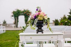 Victorian inspired centerpiece atop a vintage furniture piece at a Castle Hill Inn wedding in Newport, RI