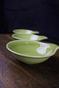 "Stunning trio of Russel Wright Lugged Soup Bowls in chartreuse. Russel Wright pieces were manufactured between 1939 - 1959. Each bowl measures approximately 5 1/4"" W x 1 1/2"" D from rim to rim. From handle to rim is 6 1/8"". The Russel Wright signature is visible on the bottom of the pieces and three distinct kiln marks indicative of Russel Wright are on the sides of each bowl. https://www.etsy.com/listing/203043879/trio-of-russel-wright-chartreuse-lugged?"
