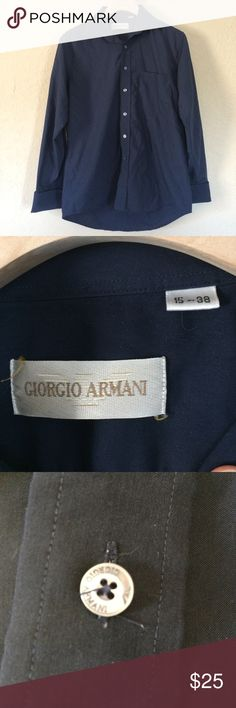Giorgio Armani Mens Dress Shirt Sharp-looking navy long-sleeve shirt with pocket from Giorgio Armani Cotton/Poly mix fabric and french cuffs. Great condition; no stains, wear or other major issues. Does require cuff links (not included). A little boxy in the body and wide in the sleeves but I love the look. Shoulders fit like a Small/Medium (Schmedium) Giorgio Armani Shirts Dress Shirts