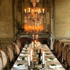 Romantic dining table with oval back dining chairs and crystal chandelier in a French chateau. South of France Fixer Upper Château Gudanes.