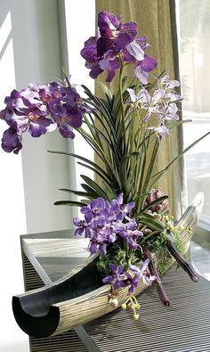 Purple Vanda Orchid in bamboo boat vase