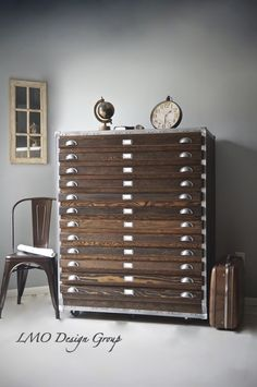 All Wood Industrial 12 drawer Handmade Apothecary Chest of drawers with metal hardware. Great use for large paper filing. Oversized filing cabinet. It has 6 wheels for ease of movement and label ho...