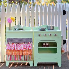 DIY play kitchens from old entertainment centers, nightstands, and desks ... Perfect for Hope!