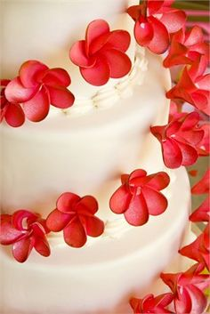 White and red circular floral wedding cake