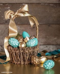 Make your own decorated easter eggs using tiny little flowers and gold leaf.