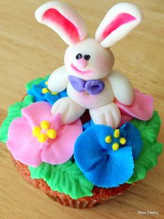 Buttercream flowers and fondant boy bunny
