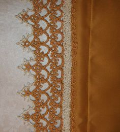 """Wedding Set       A nice edging for a wedding present, on a pair of pillowcases.  Tatted with size 10 crochet thread in gold, with a gold filament and white, with a gold filament.  The pattern is from """"The Tatted Artistry of Teiko Fujito"""", by Teiko Fujito."""