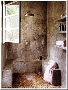"""idea of """"wet room"""" - entire room becomes shower space; built-in seating"""