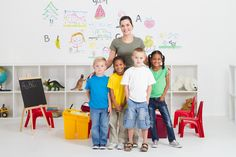 Photo about A small happy kindergarten class posing for a portrait with their young pretty teacher in classroom. Baby Boy Bedding Sets, Baby Boy Rooms, Green Boys Room, Dry Erase Paint, Boy Room Paint, Baby Boy Decorations, Kids Gift Baskets, Baby Shower Gifts For Boys, Visual Texture