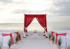 Red sashes tie towards the aisle and alternate with ivory
