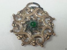 Copper tone pendant with a green stone art deco vintage antique