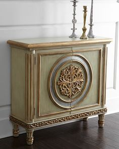Fontaine Chest A large center leaf medallion, decorative moldings, and raised fluting along the side posts give this hall chest a definitive French feel. A light palette softens the ornate embellishments.      Made of wood with decorative golden trim and overlay.