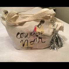 Juicy Couture Canvas Duffle Bag Canvas color with champagne pic on bag and couture noir juicy. A removable silver tassel, metallic. The juicy couture name is written on. Inside of the bag on the trim is dark chocolate with pink flowers. Inside pocket. Gorgeous... {Never Used} Juicy Couture Other