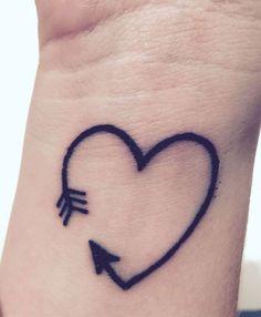 15 Amazing Arrow Tattoos for Females: . Heart Arrow Tattoo on wrist – A cute tiny heart tattoo for girls; Tiny Heart Tattoos, Mini Tattoos, New Tattoos, Tattoos For Guys, Flame Tattoos, Arrow Tattoos For Women, Cute Tattoos For Women, Tattoo Women, Pretty Tattoos For Girls