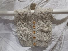 baby's hand knitted aran waistcoat by IncywincyCashmere on Etsy, £19.99