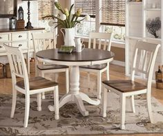 White & Brown round farmhouse dining table