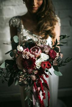winter wedding bouquets luxurious burgundy cascade bouquet damian brandon via instagram