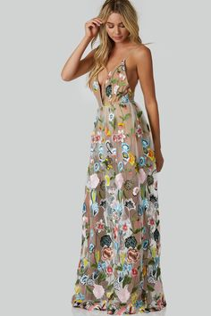 Stunning sleeveless maxi dress with plunging V-neckline and colorful embroidery throughout. Sexy open back with strappy design and nude bodysuit lining.