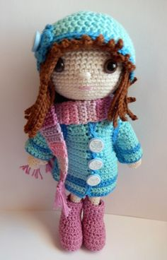 This crochet amigurumi clothing pattern is made for Emily the dress up doll. It includes a coat, boots, scarf and two different hats.
