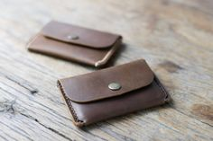 The envelope wallet is a super minimalist card wallet.  The main pocket holds your cards, secured with a closure snap.  While the reverse side card slot holds your most used, quick access cards.  ————————————————————— [ PRODUCT FEATURES ] —————————————————————  ♦ Our signature hand-stitching ♦ Closed dimensions 2.5 by 4.25 ♦ Rustic distressed leather that only seems to get better with age ♦ Slim design that goes nearly invisible in front or rear jeans pockets.  ————————————————————— […