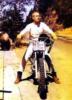 """Paul Newman — this pic is flawess. From the white jeans, to the boots, to the dirtbike. 1971 ~ Paul Newman in Oregon on the set of """"Sometimes a Great Notion,"""" boning up on his off-road skills under the wing of the great J.N. Roberts – a top desert / off-road racer in the '60s – '70s. Roberts (along with his teammate Malcolm Smith, Steve McQueen, and others) tore it up onscreen in Bruce Brown's seminal (1971) motorcycle film, """"On Any Sunday."""