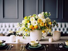 Inspired and delightful mix of golds and soft  yellow blooms for a centerpiece.