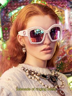 Lighting up the Gucci Fall Winter 16 campaign: oversized cat-eye sunglasses with gold metal star studs, earrings with feline head details and a pearl-embroidered puffed sleeve merino and cashmere knit.